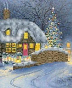 kersthuisje in landschap