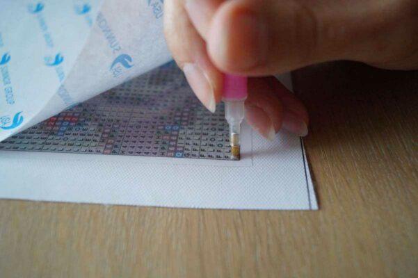Diamond painting steentjes indrukken